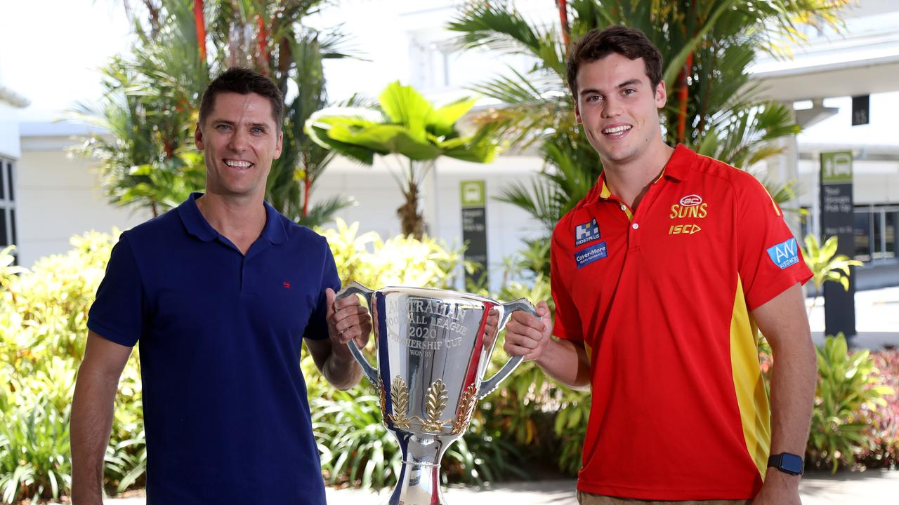 Simon Black and Jack Bowes arrive in Cairns with the AFL premiership cup, part of its tour around Queensland ahead of the grand final in Brisbane. PICTURE: STEWART McLEAN