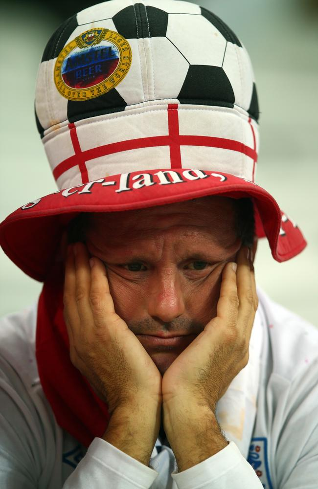 This England fan may have been upset by the result against Uruguay or he could have just checked the latest Test cricket scores.