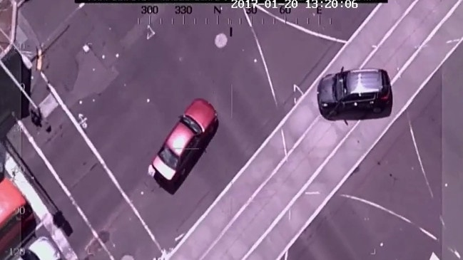 Footage released shows Gargasoulas close passing cars and driving on tram lines before doing burnouts at the intersection of Bourke and Flinders street.