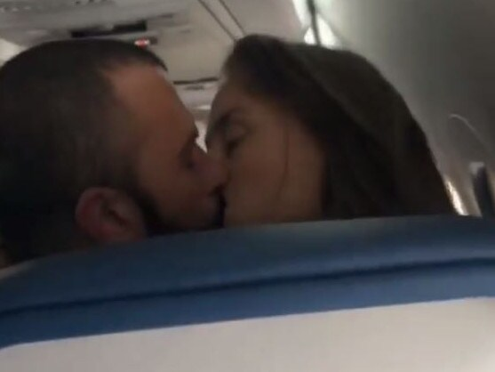 The two passengers were filmed in an intimate moment on the plane. Picture: @loaltitude