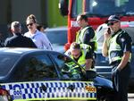 Police attend the scene of a light plane crash into DFO at Essendon Airport in Victoria. Picture : Ian Currie