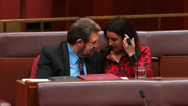 Senator Derryn Hinch talking with Senator Jacqui Lambie. Photo: Kym Smith
