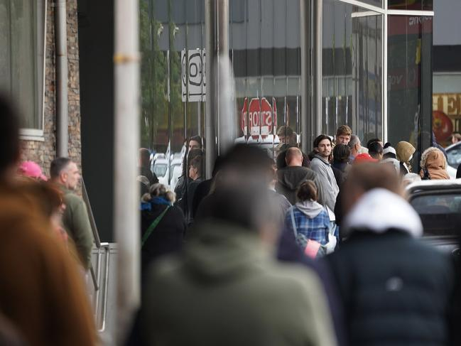 People lined up outside a Centrelink office in Preston, Melbourne. Picture: AAP