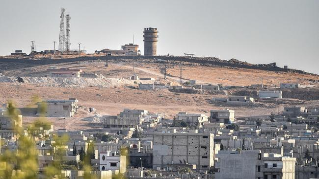 A picture taken on October 12, 2019 from Turkey near the town of Suruc shows a US observation post near the Syrian town of Kobani where the Pentagon said an explosion occurred. Picture: Ozan Kose/ AFP