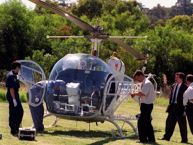 Police inspecting the helicopter used in escape of Killick from Silverwater prison.