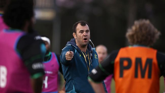 Wallabies coach Michael Cheika gives his players instructions at Cessnock Sportsground.