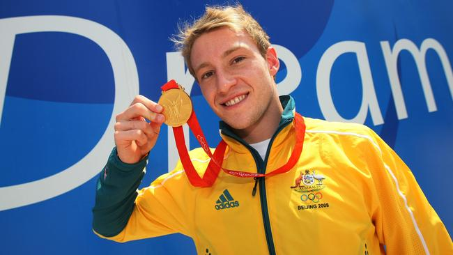 Matthew Mitcham parades his gold medal at the Beijing Olympics. Picture: Adam Head