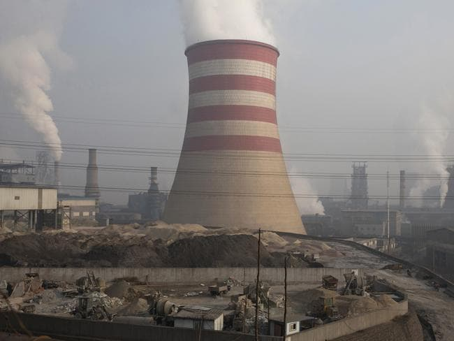 Smoke and steam spew from the sprawling complex that is a part of the Jiujiang steel and rolling mills in Qianan in northern China's Hebei province. Picture: AP