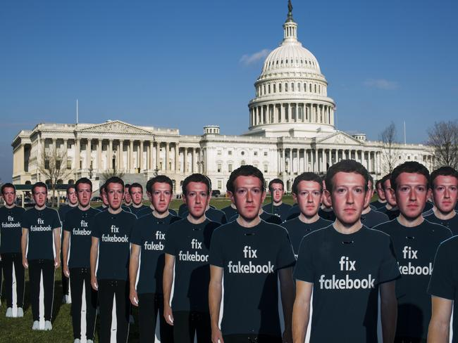About 100 life-size cutouts of Facebook CEO Mark Zuckerberg sit on the lawn of the U.S. Capitol. Picture: Getty