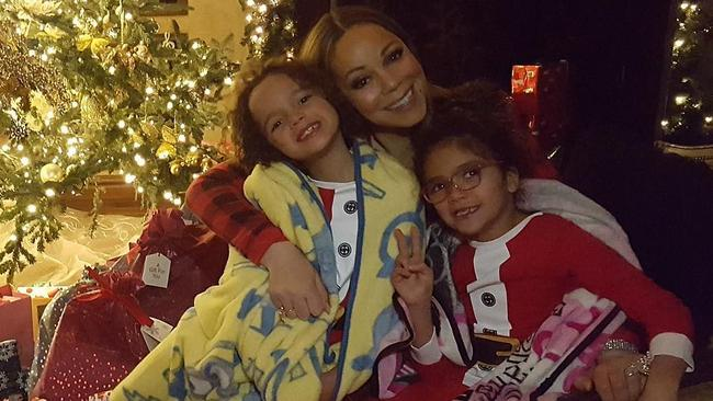 Mariah Carey celebrating Christmas with her twins.