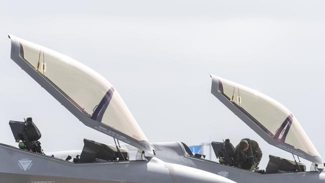 Two Royal Australian Air Force F-35 aircraft sit on the tarmac at Avalon airport. A unit of the aircraft has been grounded in the US after experiencing oxygen supply issues. Picture: AFP/Jeremy R Dixon