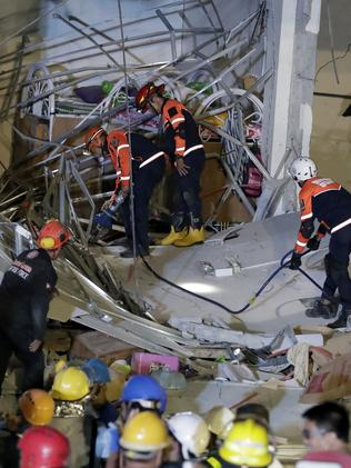 Rescuers continue to search for survivors in a collapsed commercial building in Porac. Picture: Bullit Marquez