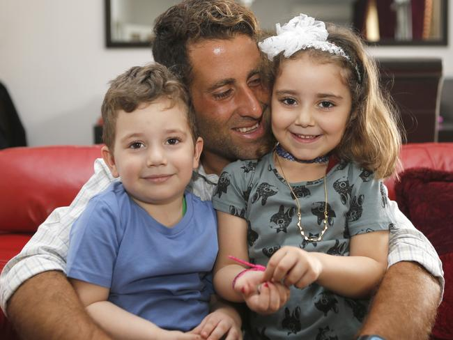 Noah and Lahela al-Amin pose for a picture with their father Ali Zeid al-Amin at home in Beirut. Picture: The Daily Star/Mohammad Azakir.