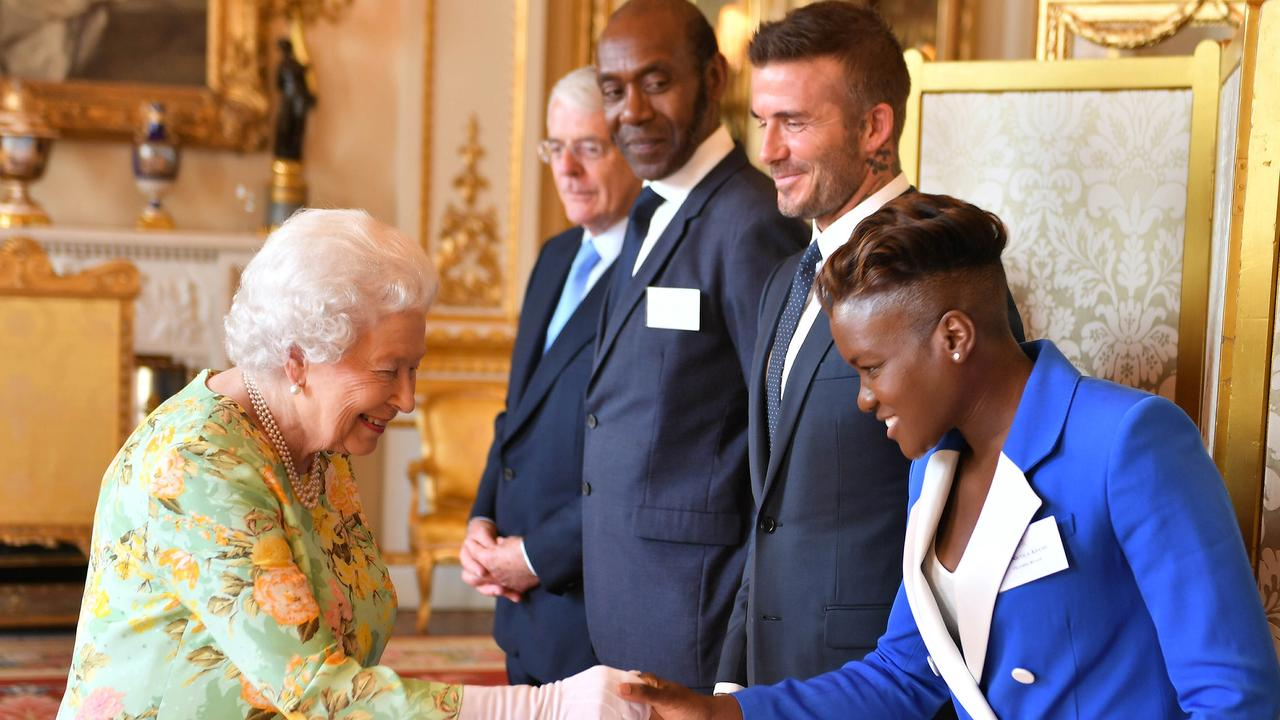 The Queen greets former Sir John Major, comedian Lenny Henry, David Beckham and Olympic boxing gold medallist Nicola Adams at the Queen's Young Leaders Awards ceremony. Picture: MEGA
