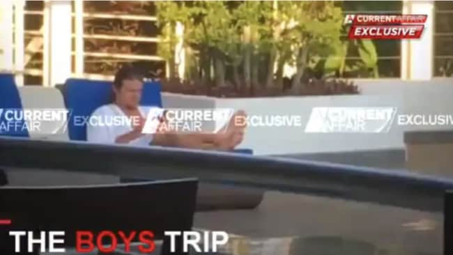 """Nick living """"the bachelor lifestyle"""" aka sitting by the pool Source: Channel 9"""