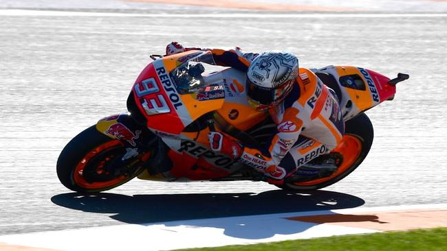 Marc Marquez takes a curve during a MotoGP practice session of the Valencia GP.
