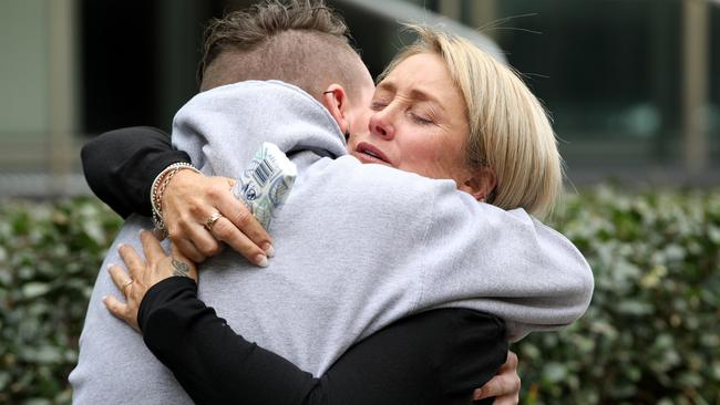 Denise Chase, the mother of Mitchell Chase, is comforted by family and friends outside court after the sentencing. Picture: AAP/Richard Wainwright