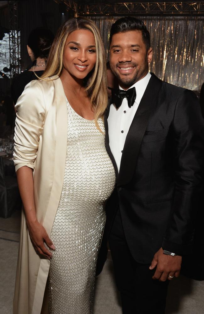Singer Ciara, while she was pregnant with her daughter Sienna Princess, with her husband, NFL player Russell Wilson. Picture: Michael Kovac/Getty Images for EJAF