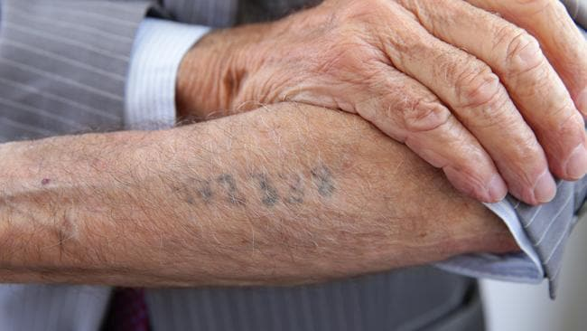 Mr Jaku still bears the tattoo of his Nazi prisoner number on his forearm. Picture: News Corp Australia