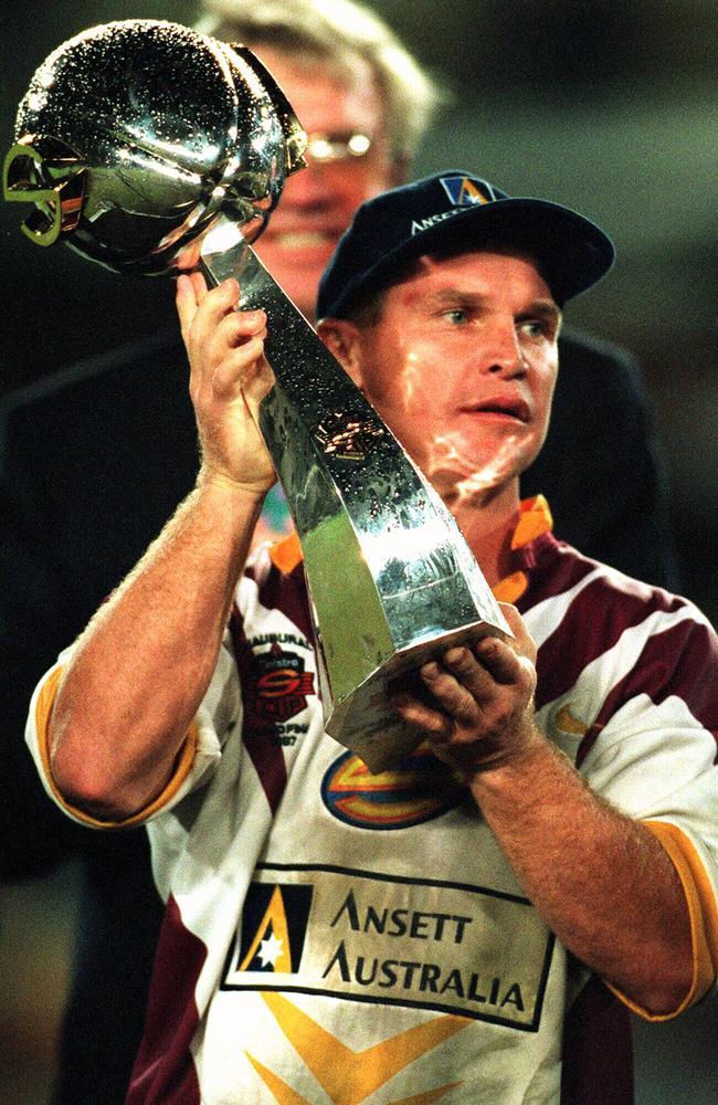 Broncos captain Allan Langer holds Telstra Cup trophy aloft.
