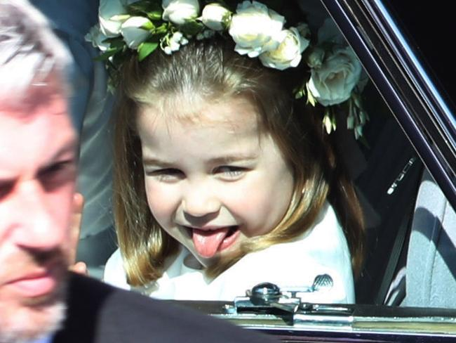 Princess Charlotte pokes her tongue out at the crowd as she rides in a wedding car to Prince Harry and Meghan Markle's wedding on May 19. Picture: Andrew Milligan – WPA/Getty Images