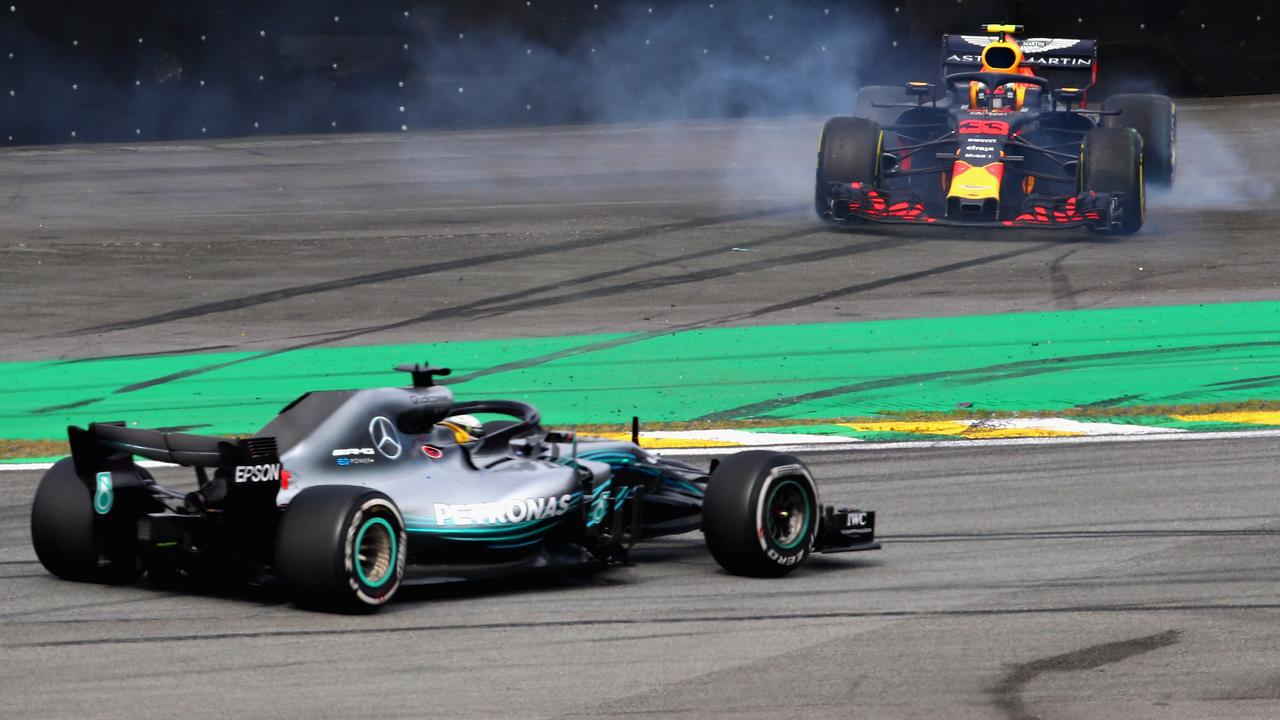 Hamilton passes Verstappen as he spins after being hit by Ocon. Picture: Mark Thompson