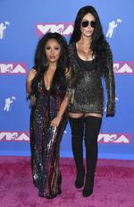 "Nicole Polizzi, left, and Jennifer Lynn ""JWOWW"" Farley arrive at the MTV Video Music Awards at Radio City Music Hall on Monday, Aug. 20, 2018, in New York. Picture: Evan Agostini/Invision/AP"