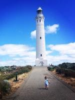 """<b>2. CAPE LEEUWIN LIGHTHOUSE, WA:</b> After reading the """"Light Between Oceans"""" by Australian author M.L Stedman I quickly added a trip to this lighthouse to my bucket list. This image captures my niece running towards the lighthouse where the Indian and Southern Oceans meet. If you've read the book, this image could easily translate to be Lucy running up to meet Tom. Picture: Leah Smileski, NSW"""