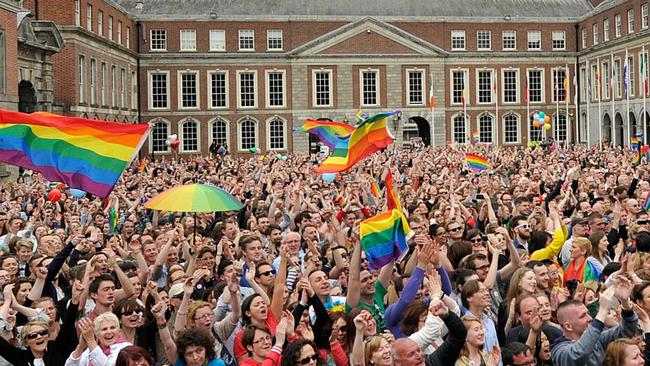 Thousands celebrate the same-sex marriage vote at Dublin Castle in Ireland in 2015. Picture: Clodagh Kilcoyne/Getty Images.