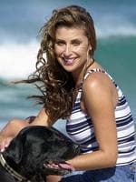 Mannequin and fashion designer Jodhi Packer and dog Tenzin on Bondi Beach 10 Aug 2001.