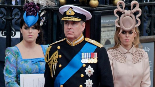 Prince Andrew with daughters Eugenie and Beatrice. Image: AP Photo/Gero Breloer.