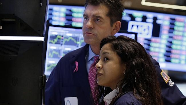 Traders work on the floor of the New York Stock Exchange. The prospect of a default has lead to volatile markets this week. Picture: AP