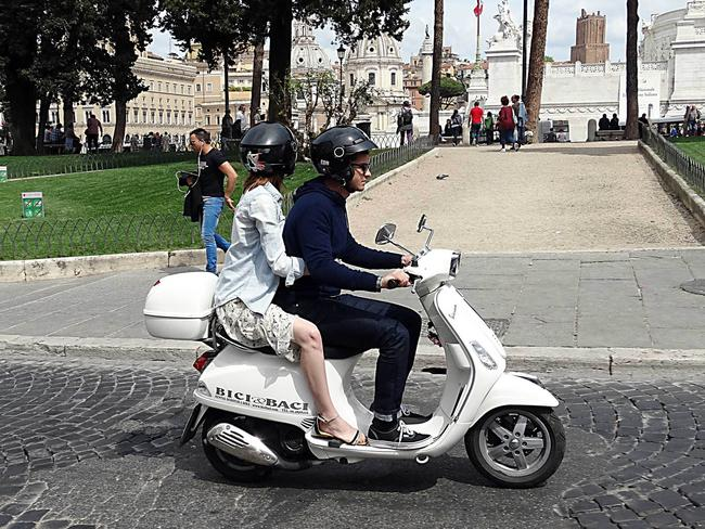 NO: A barelegged and sandalled Emma Stone with Andrew Garfield enjoying a tour of Rome riding a Vespa.