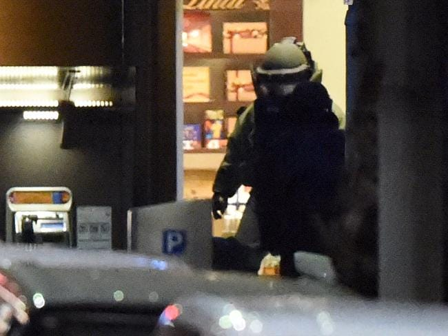 A bomb disposal expert is pictured after police stormed the Sydney cafe where two hostages were killed.