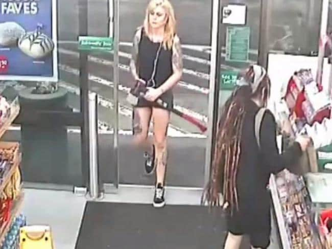 Evie Amati enters the 7-Eleven in Enmore carrying a 2kg axe, with Sharon Hacker at the till buying milk.