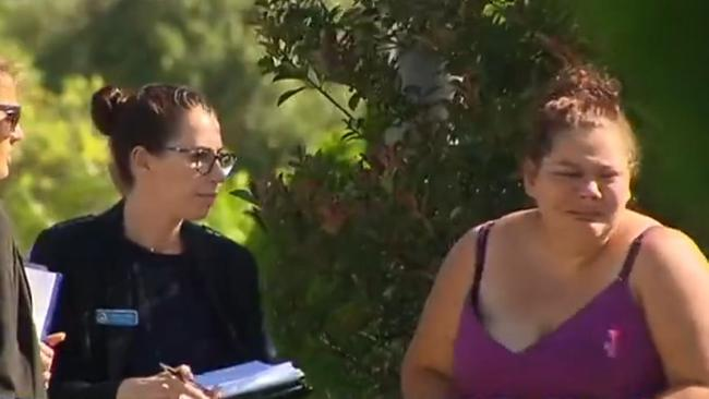 A woman, believed to be the boy's mother, is assisted by detectives. Picture: 7News