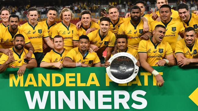 The Wallabies are seen celebrating with the Mandela Plate at Suncorp Stadium.