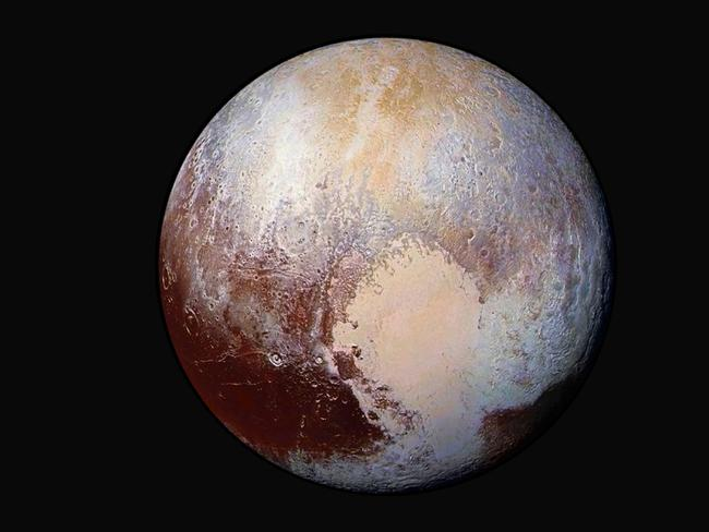This image made available by NASA on July 24, 2015 shows a combination of images captured by the New Horizons spacecraft with enhanced colours to show differences in the composition and texture of Pluto's surface.