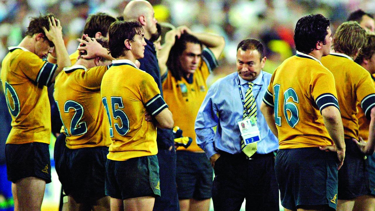 Australian coach Eddie Jones reacts with his players after losing the Rugby World Cup final.