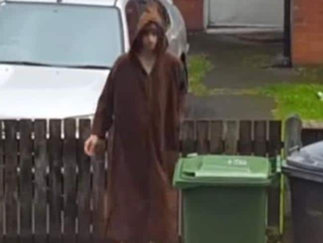 New pictures have emerged of Salman Abedi putting the bins out outside his Manchester home while wearing a brown robe.