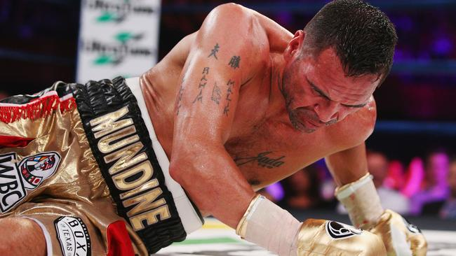 Anthony Mundine on the canvas after being knocked down by Charles Hatley.