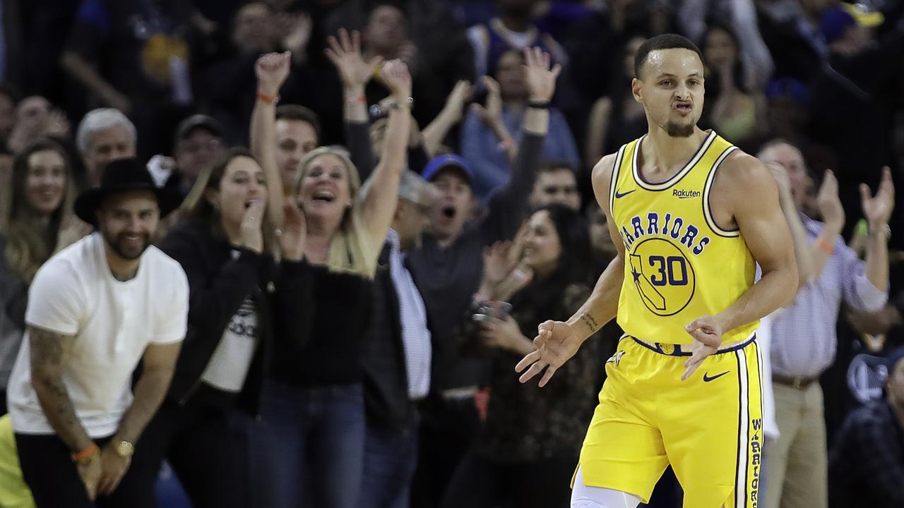 Golden State Warriors' Stephen Curry celebrates.