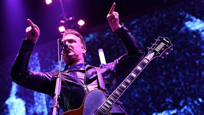 Queens of the Stone Age singer apologises for kicking photographer: 'I was a d**k'