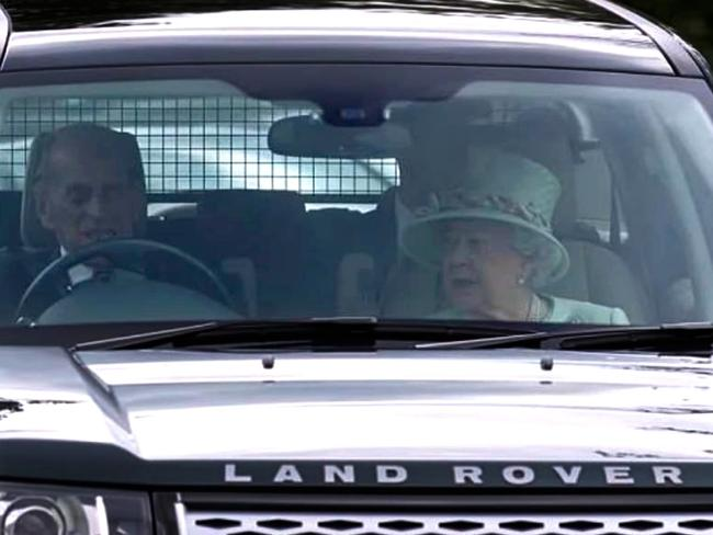 Prince Philip driving himself around the Queen's country estates.