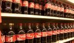 Coke bottles at supermarket.