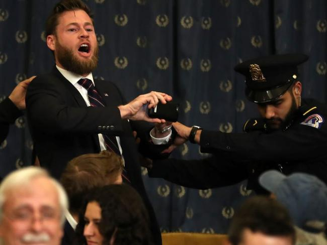 The heckler shouts that the democrats have 'committed treason'. Picture: CNBC