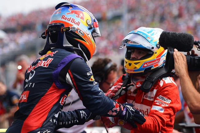 Alonso congratulating Ricciardo after the 2014 Hungarian GP.