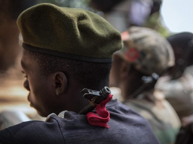 Child soldiers sit as they attend their release ceremony. Picture: AFP PHOTO/Stefanie Glinski