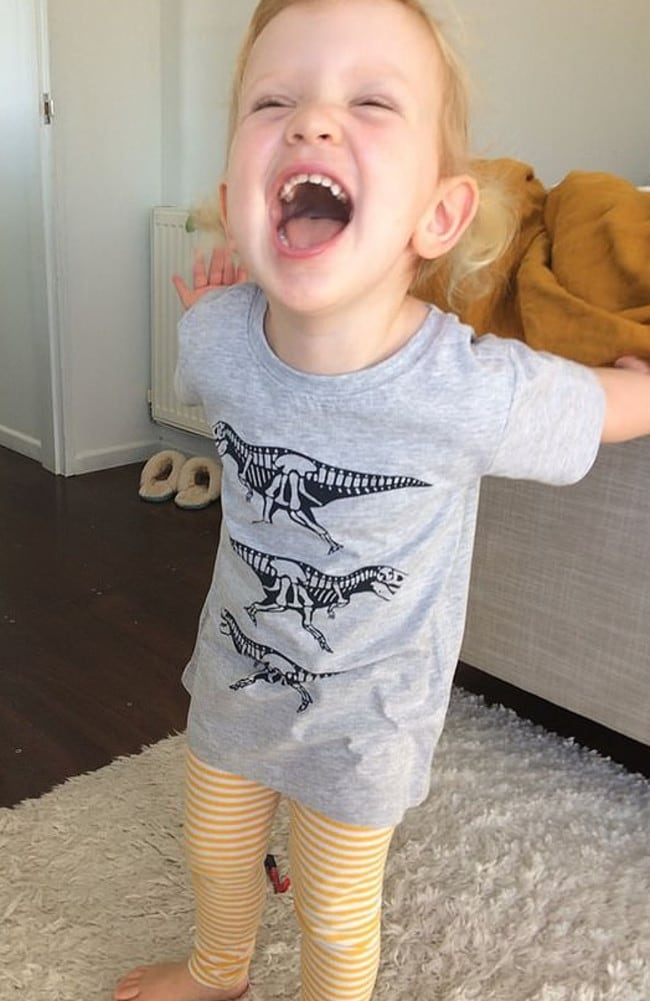 Little Lola looks delighted with her dinosaur T-shirt. Picture: Facebook / India Springle