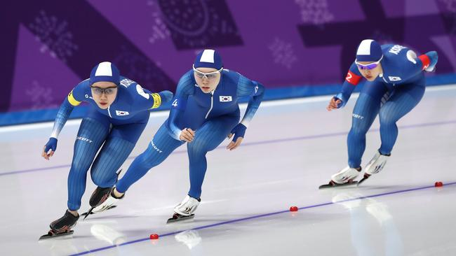 Ji Woo Park, Seon-Yeong Noh and Bo-Reum Kim compete during the Ladies' Team Pursuit Speed Skating Quarterfinals. Seon-Yeong (middle) would later fall behind her teammates. (Photo by Ronald Martinez/Getty Images)